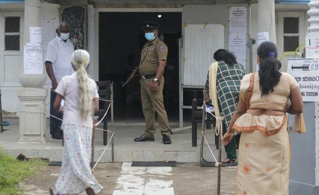 Women arrive to cast votes (Eranga Jayawardena/AP)